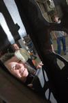 Bower artist Lynn Basa peering inside sculpture