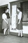 1940s looking at charts
