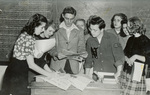 1945 group looking at newspapers