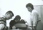 1965 working with adding machine