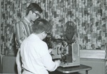 1965 working with the film projector