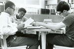 Garrison, Austin and Schmidt studying in library