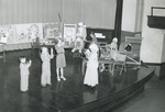 Pageant with white wigs