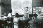 Student at the world map