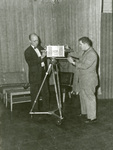 1957 with Bob Davis inspecting TV camera