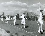 1956 football cheerleaders on the field