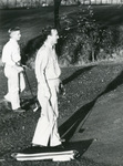 1991 golfers waiting to putt