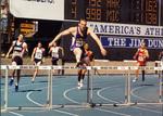 1990s Joey Woody running hurdles