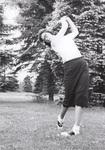 Female student golfing