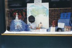 Images of downtown Postville storefronts created by Diversity Council, 2000-2002