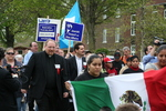 Father Paul Ouderkirk, Pastor David Vasquez, marchers by Julie Berg-Raymond