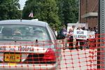 Police car, protestors