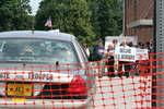 Police car, protestors by Julie Berg-Raymond