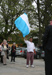 Sister Mary McCauley, marcher with Guatemalan flag by Julie Berg-Raymond