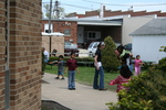Children playing outside church with volunteers by Julie Berg-Raymond
