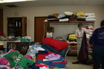 Volunteers folding clothes at St. Bridget's Catholic Church by Julie Berg-Raymond