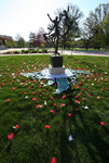 Flowers are arranged around the Tree of Life statue, using a fabric wheel by Julie Berg-Raymond