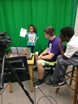 UNI 3D Student Explains Green Screen Technology to WWP Authors During their Visit to the Rod Library