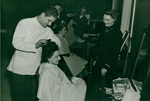 M. L. Rader gets Navy haircut