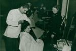 M. L. Rader gets Navy haircut